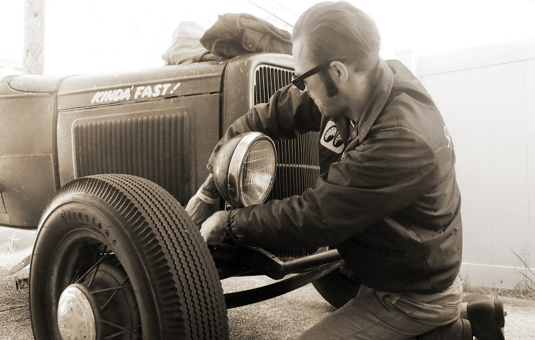 Willow Street Pictures| man works on his vintage car