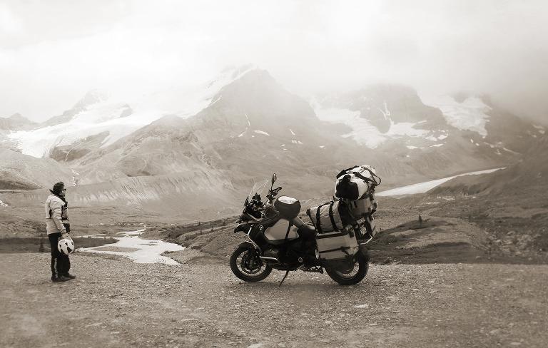 man overlooking a glacier