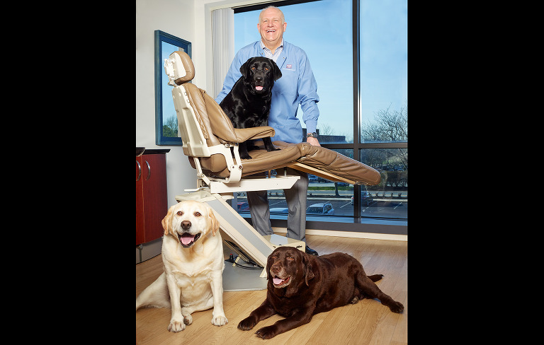 Willow Street Pictures| a dentist with his three labradors in an exam room